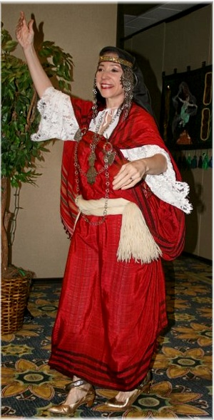 Habiba preforming in Tunisian costuming