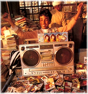 boy vendor sells Shaabi cassettes