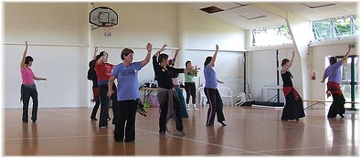 New Zealand dancers learning Cassandra Shore's saidi-styled choreography Nar at Oasis Dance Camp Aotearoa in 2007