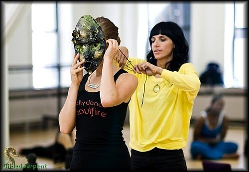 Co-teacher Dixie Rose of P.U.R.E. puts a mask on conference attendee Karolina