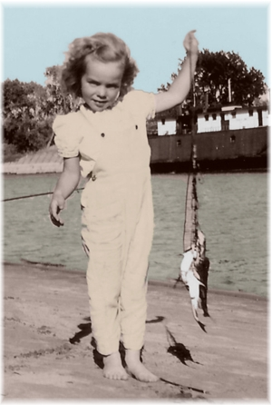 Little Najia catches a catfish