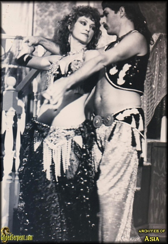 Asia and John dance together in Hollywood in 1984